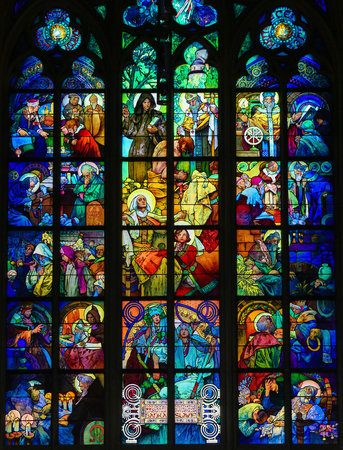 episodes: PRAGUE, CZECH REPUBLIC - APRIL 2, 2016: Stained Glass window of the Czech Patron Saint St. Wenceslas with his grandmother St. Ludmila surrounded by episodes from the lives of Saints Cyril and Methodius  in St. Vitus Cathedral, Prague, designed by Alphonse