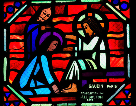 AMIENS, FRANCE - FEBRUARY 9, 2013: Mary Kneels Weeping before Christ with Martha, Stained Glass in the Cathedral of Amiens, France, by J. Le Breton.