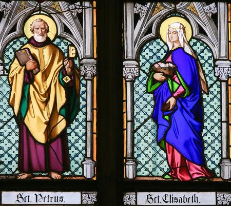 keys to heaven: PRAGUE, CZECH REPUBLIC - APRIL 2, 2016: Stained Glass window in St. Vitus Cathedral, Prague, depicting Saint Peter and Saint Elisabeth