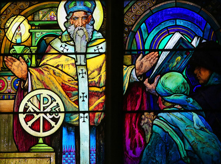 missionary: PRAGUE, CZECH REPUBLIC - APRIL 2, 2016: Stained Glass window in St. Vitus Cathedral, Prague, designed by Alphonse Mucha, depicting Saint Methodius