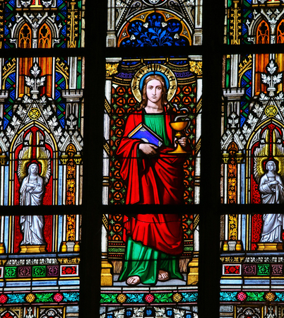 evangelist: PRAGUE, CZECH REPUBLIC - APRIL 2, 2016: Stained Glass window in St. Vitus Cathedral, Prague, depicting Saint Johan the Evangelist