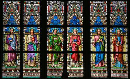 PRAGUE, CZECH REPUBLIC - APRIL 2, 2016: Stained Glass window in St. Vitus Cathedral, Prague, depicting various Roman Catholic Saints Éditoriale