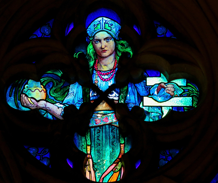 religious clothing: PRAGUE, CZECH REPUBLIC - APRIL 2, 2016: Detail of the Stained Glass window in St. Vitus Cathedral, Prague, designed by Alphonse Mucha. Editorial