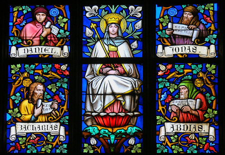the prophets: PRAGUE, CZECH REPUBLIC - APRIL 2, 2016: Stained Glass window in St. Vitus Cathedral, Prague, depicting Mother Mary and the Prophets Daniel, Jonah, Zachary and Abdias.