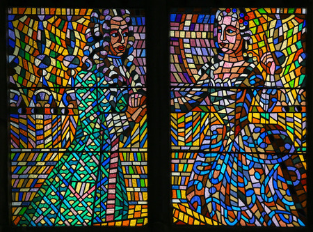 whig: PRAGUE, CZECH REPUBLIC - APRIL 2, 2016: Stained Glass window in St. Vitus Cathedral, Prague, depicting a man and woman with a Baroque outfit engaged in courtship. Editorial