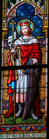 patron: PRAGUE, CZECH REPUBLIC - APRIL 2, 2016: Stained Glass window in St. Vitus Cathedral, Prague, depicting Saint Wenceslas, patron saint of the Czech Republic