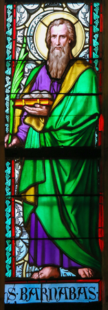 disciples: PRAGUE, CZECH REPUBLIC - APRIL 2, 2016: Stained Glass window in St. Vitus Cathedral, Prague, depicting Barnabas, born Joseph, an early Christian, one of the prominent Christian disciples in Jerusalem