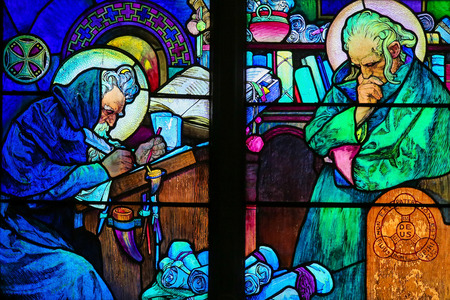 theologian: PRAGUE, CZECH REPUBLIC - APRIL 2, 2016: Stained Glass window in St. Vitus Cathedral, Prague, designed by Alphonse Mucha, depicting Saints Cyril and Methodius