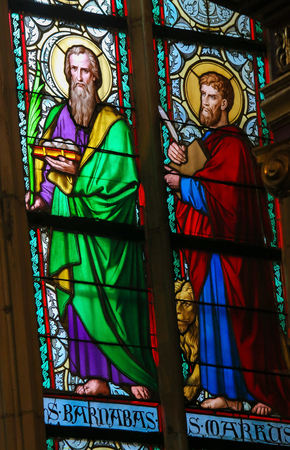 evangelist: PRAGUE, CZECH REPUBLIC - APRIL 2, 2016: Stained Glass window in St. Vitus Cathedral, Prague, depicting Saint Barnabas and Saint Mark the Evangelist