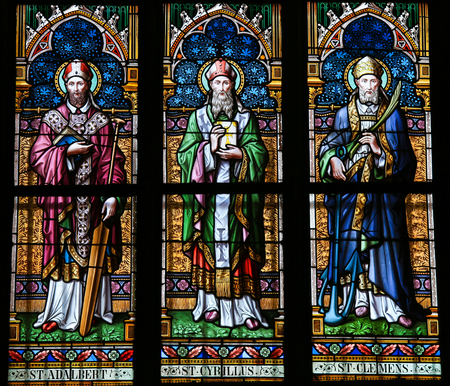 clement: PRAGUE, CZECH REPUBLIC - APRIL 2, 2016: Stained Glass window in St. Vitus Cathedral, Prague, depicting Saints Adalbert of Prague, Cyril and Clement.