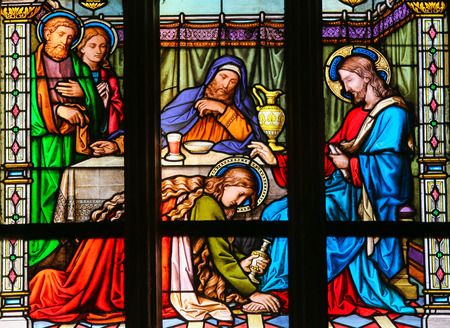 anoint: PRAGUE, CZECH REPUBLIC - APRIL 2, 2016: Stained Glass window in St. Vitus Cathedral, Prague, depicting Mary Magdalen anointing Christ's feet Editorial