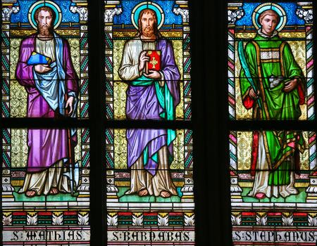saint stephen cathedral: PRAGUE, CZECH REPUBLIC - APRIL 2, 2016: Stained Glass window in St. Vitus Cathedral, Prague, depicting Saint Mathias, Saint Barnabas and Saint Stephen