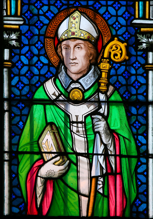 PRAGUE, CZECH REPUBLIC - APRIL 2, 2016: Stained Glass window in St. Vitus Cathedral, Prague, depicting Saint Wolfgang of Regensburg (934 – 994), bishop of Regensburg in Bavaria. Editorial