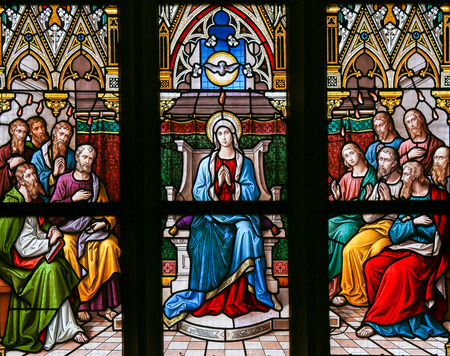 pentecost: PRAGUE, CZECH REPUBLIC - APRIL 5, 2016: Stained Glass in the Basilica of Vysehrad in Prague, Czech Republic, depicting the Descent of the Holy Spirit at Pentecost