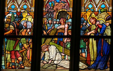 via dolorosa: PRAGUE, CZECH REPUBLIC - APRIL 5, 2016: Stained Glass in the Basilica of Vysehrad in Prague, Czech Republic, depicting Jesus Christ falling under the cross on the Via Dolorosa