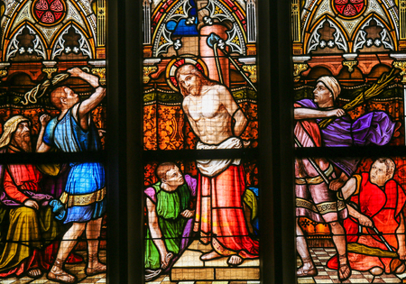 scourging: PRAGUE, CZECH REPUBLIC - APRIL 5, 2016: Stained Glass in the Basilica of Vysehrad in Prague, Czech Republic, depicting the Flagellation of Christ