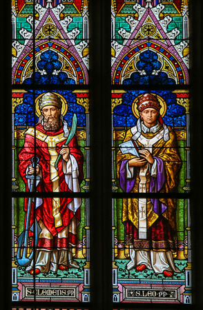clement: PRAGUE, CZECH REPUBLIC - APRIL 5, 2016: Stained Glass in the Basilica of Vysehrad in Prague, Czech Republic, depicting Saint Clement of Rome and Pope Saint Leo I Editorial