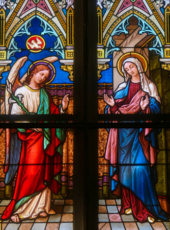 gabriel: PRAGUE, CZECH REPUBLIC - APRIL 5, 2016: Stained Glass in the Basilica of Vysehrad in Prague, Czech Republic, depicting the Annunciation