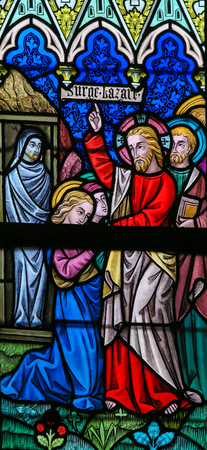 lazarus: LIER, BELGIUM - MAY 16, 2015: Stained Glass window (1886) in St Gummarus Church in Lier, Belgium, depicting the Raising of Lazarus, a miracle performed by Jesus.