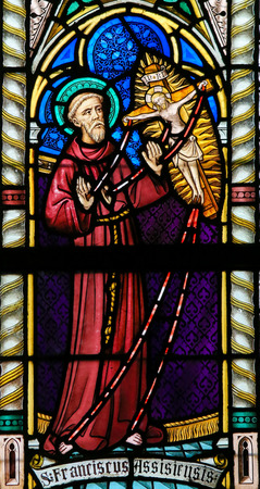 lier: LIER, BELGIUM - MAY 16, 2015: Stained Glass window in St Gummarus Church in Lier, Belgium, depicting St Francis of Assisi