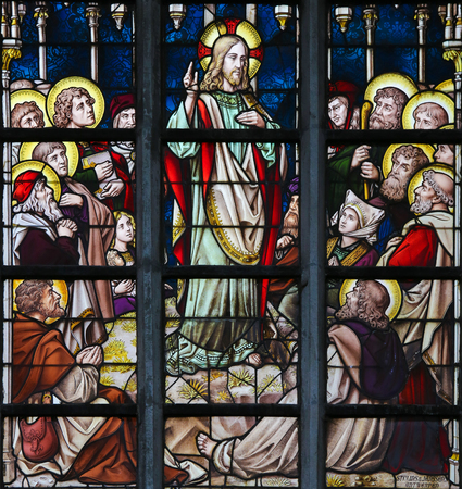 LIER, BELGIUM - MAY 16, 2015: Stained Glass window in St Gummarus Church in Lier, Belgium, depicting the Sermon on the Mount