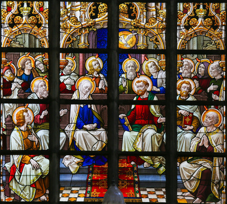 lier: LIER, BELGIUM - MAY 16, 2015: Stained Glass window in St Gummarus Church in Lier, Belgium, depicting the gathering of Mary and the Apostles at Pentecost Editorial