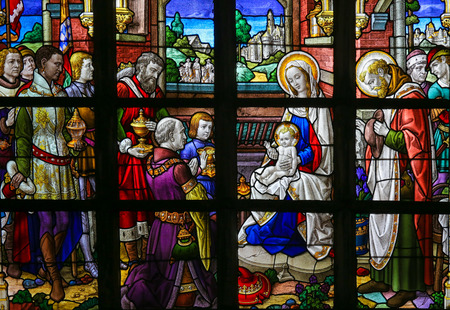 lier: LIER, BELGIUM - MAY 16, 2015: Stained Glass window in St Gummarus Church in Lier, Belgium, depicting the Visit of the Three Kings or Three Wise Men