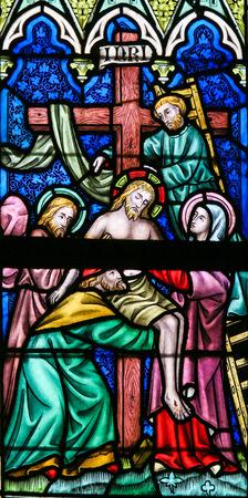 lier: LIER, BELGIUM - MAY 16, 2015: Stained Glass window in St Gummarus Church in Lier, Belgium, depicting Jesus taken from the Cross
