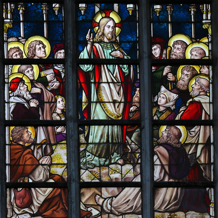 the sermon: LIER, BELGIUM - MAY 16, 2015: Stained Glass window in St Gummarus Church in Lier, Belgium, depicting the Sermon on the Mount