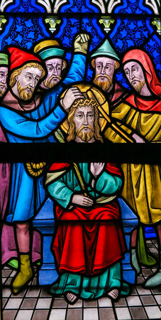lier: LIER, BELGIUM - MAY 16, 2015: Stained Glass window in St Gummarus Church in Lier, Belgium, depicting the Crown of Thorns placed on Jesus head on Good Friday