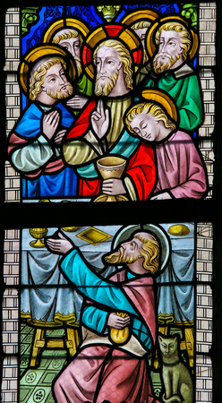 thursday: LIER, BELGIUM - MAY 16, 2015: Stained Glass window in St Gummarus Church in Lier, Belgium, depicting Jesus and the Apostles at the Last Supper, with the traitor Judas Iscariot in front.