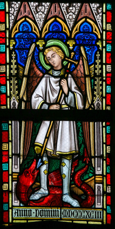 LIER, BELGIUM - MAY 16, 2015: Stained Glass window(1886)  in St Gummarus Church in Lier, Belgium, depicting Saint Michael the Archangel, slaying the Dragon. Éditoriale