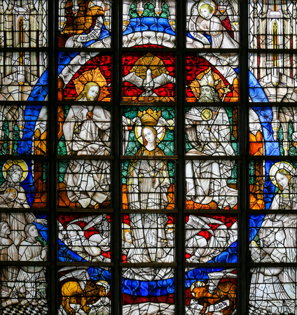 blessed trinity: LIER, BELGIUM - MAY 16, 2015: Stained Glass window (1450) in St Gummarus Church in Lier, Belgium, depicting the Coronation of Mary