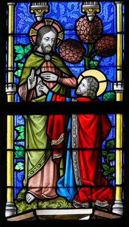 lier: LIER, BELGIUM - MAY 16, 2015: Stained Glass window in St Gummarus Church in Lier, Belgium, depicting Saint Thomas touching Jesus wound