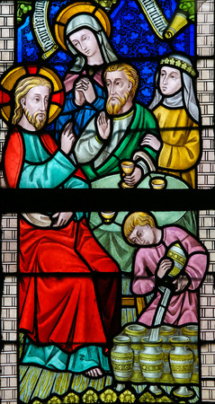 attributed: LIER, BELGIUM - MAY 16, 2015: Stained Glass window in St Gummarus Church in Lier, Belgium, depicting the Marriage at Cana or Wedding at Cana, a miracle attributed to Christ. Editorial
