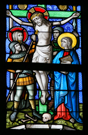 lier: LIER, BELGIUM - MAY 16, 2015: Stained Glass window in St Gummarus Church in Lier, Belgium, depicting Jesus on the Cross and Longinus