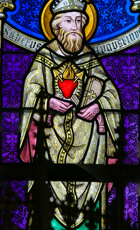 theologian: LIER, BELGIUM - MAY 16, 2015: Stained Glass window (1895) in St Gummarus Church in Lier, Belgium, depicting Saint Augustine Editorial