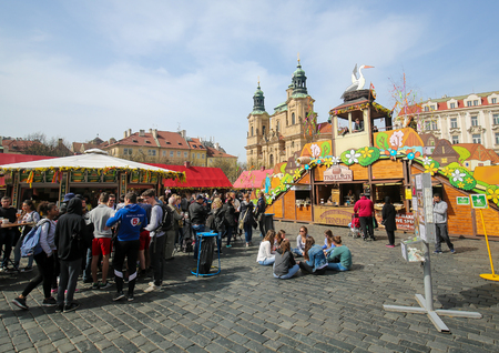 st nicholas cathedral: PRAGUE, CZECH REPUBLIC - APRIL 3, 2016: Easter market near St. Nicolas Church in the Old Town Square in the historic center of Prague, Czech Republic