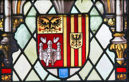 lier: LIER, BELGIUM - MAY 16, 2015: Stained Glass window in St Gummarus Church in Lier, Belgium, depicting the Coat of Arms of the Province of Antwerp in Flanders, Belgium, consisting of the shields of Antwerp, Mechelen and Turnhout.