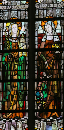 lier: LIER, BELGIUM - MAY 16, 2015: Stained Glass window in St Gummarus Church in Lier, Belgium, depicting Saint Barbara and Saint Elisabeth Editorial