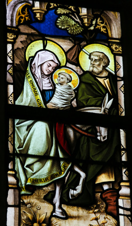 lier: LIER, BELGIUM - MAY 16, 2015: Stained Glass window in St Gummarus Church in Lier, Belgium, depicting Joseph, Mary and Jesus on their way to Egypt.