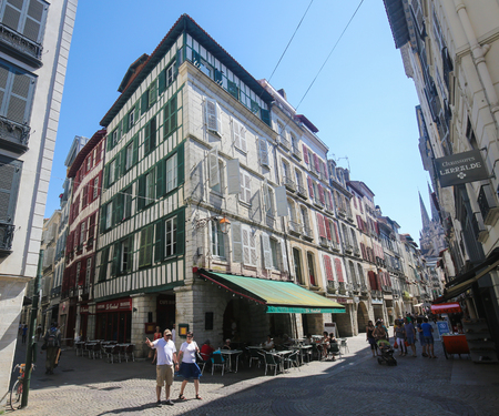 gascony: BAYONNE, FRANCE - JULY 9, 2016: Old houses in the center of Bayonne, a city in the Aquitaine region of south-western France.