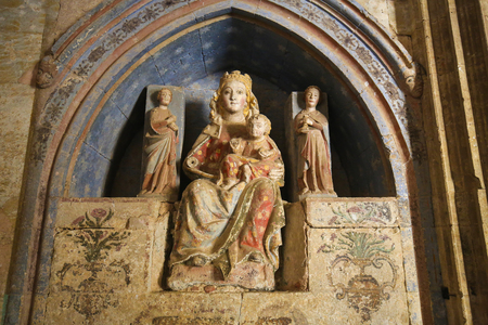 salamanca: Medieval Statue of Mother Mary and Child in Ciudad Rodrigo, a border town in Castile and Leon, Spain.