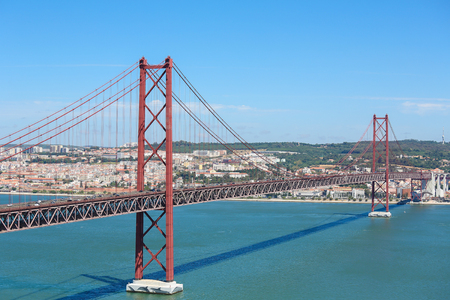 the tagus: Ponte 25 de Abril across the Tagus river and view on the center of Lisbon, Portugal