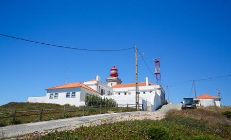 roca: The lighthouse at Cabo da Roca, a cape located close to Lisbon which forms the westernmost extent of mainland Portugal and continental Europe. Stock Photo