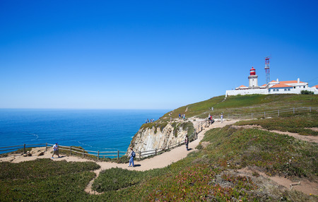 SINTRA, PORTUGAL - JULY 15, 2016: The lighthouse at Cabo da Roca, a cape located close to Lisbon which forms the westernmost extent of mainland Portugal and continental Europe.