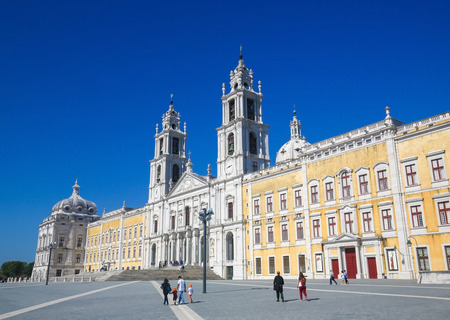 convento: MAFRA, PORTUGAL - JULY 17, 2016: Facade of the Basilica at the Palace of Mafra, Portugal, a famous royal palace built in the 18th Century.