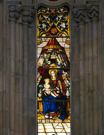 infant jesus: BATALHA, PORTUGAL - JULY 24, 2016: Stained Glass depicting Mother Mary and the Infant Jesus in the Monastery of Batalha in Portugal. Editorial