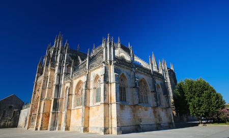Facade of the Monastery of Batalha, one of the most important Gothic sites in Portugal, created in remembrance of the 14th Century victory against Castile.