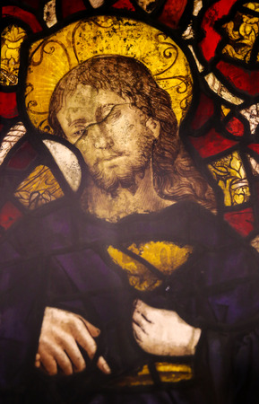 holy thursday: BATALHA, PORTUGAL - JULY 24, 2016: Stained Glass (15the Century) depicting Jesus Christ holding the Holy Grail in the Monastery of Batalha in Portugal.